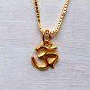 22 k gold om pendant